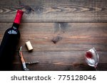 open wine bottle. glass and... | Shutterstock . vector #775128046