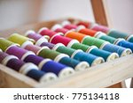 colorful thread in a wood box | Shutterstock . vector #775134118