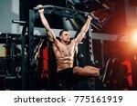 bodybuilder on the bar raises... | Shutterstock . vector #775161919