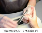 manicure in process | Shutterstock . vector #775183114