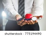 cardiologist holding red heart... | Shutterstock . vector #775194490