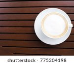 hot coffee cup on wooden table. | Shutterstock . vector #775204198