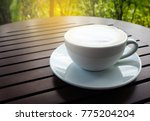 hot coffee cup on wooden table. | Shutterstock . vector #775204204