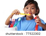 young asian girl brushing her teeth - stock photo