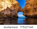 lagos caves and seashore.... | Shutterstock . vector #775227160