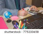 businessman using a calculator... | Shutterstock . vector #775233658