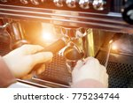 barista working in a coffee shop | Shutterstock . vector #775234744
