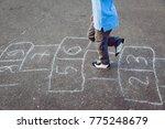 Little Boy Playing Hopscotch On ...