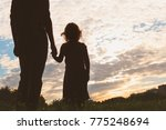 Silhouette Of Father And...