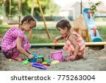 two girls play in the sandbox  | Shutterstock . vector #775263004