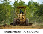 grader clearing and leveling... | Shutterstock . vector #775277893