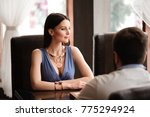 young couple playing chess | Shutterstock . vector #775294924