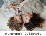 small curly girl and her mother ... | Shutterstock . vector #775304050