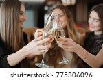 girlfriends rest in a... | Shutterstock . vector #775306096