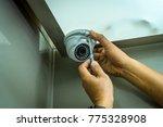 technician installing dome cctv ... | Shutterstock . vector #775328908