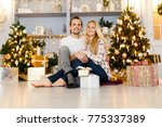 sweet couple opening christmas... | Shutterstock . vector #775337389