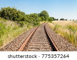 old abandoned railroad tracks | Shutterstock . vector #775357264