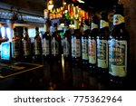 Small photo of Wapping, London, UK - 09/100/15: Bottles on bar of Captain Kidd pub.