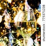 white wine or champagne in... | Shutterstock . vector #775371238