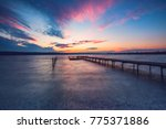 Wooden Dock And Fishing Boat A...