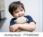 happy kid boy hugging teddy...   Shutterstock . vector #775381060