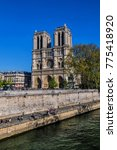 Small photo of PARIS, FRANCE - APRIL 8, 2017: Tourists visiting the Cathedral Notre Dame de Paris - most famous Roman Catholic cathedral (1163 - 1345) on the eastern half of the Cite Island.