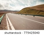 a road over the grassland | Shutterstock . vector #775425040