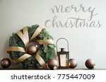 wreath with balls and lantern... | Shutterstock . vector #775447009