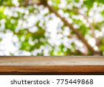 wooden table and blurred nature ... | Shutterstock . vector #775449868
