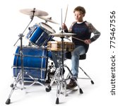 Young Blond Boy At Drum Kit In...