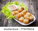 fried spring rolls. sliced... | Shutterstock . vector #775478416