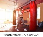 young women boxing  hitting the ... | Shutterstock . vector #775521964