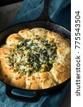 Small photo of Homemade Skillet Bread with Artichoke Dip Ready to Eat
