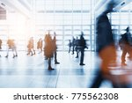 crowd of blurred people rushing ... | Shutterstock . vector #775562308
