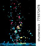 jumping drops of paint or ink... | Shutterstock . vector #775572478
