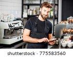 handsome waiter in black t...   Shutterstock . vector #775583560