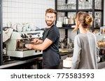 handsome barista making coffee... | Shutterstock . vector #775583593