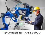 engineer using laptop computer... | Shutterstock . vector #775584970