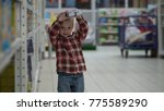 child buys baby food in a store ... | Shutterstock . vector #775589290