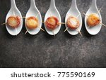 spoons with bacon wrapped... | Shutterstock . vector #775590169