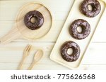 chocolate donuts on wooden... | Shutterstock . vector #775626568