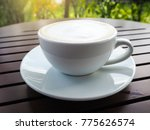 hot coffee cup on wooden table. | Shutterstock . vector #775626574