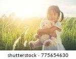 little bear hugging a bear | Shutterstock . vector #775654630