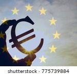 man's hand hold the euro icon... | Shutterstock . vector #775739884