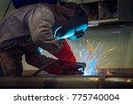 industrial welder welding... | Shutterstock . vector #775740004