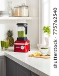 red blender with smoothies and... | Shutterstock . vector #775762540