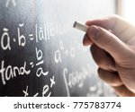 teacher writing to blackboard...   Shutterstock . vector #775783774