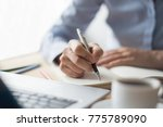 closeup of woman making notes... | Shutterstock . vector #775789090