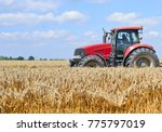 modern tractor on field works | Shutterstock . vector #775797019