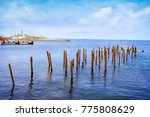 Piles Stick Out Of The Water Of ...